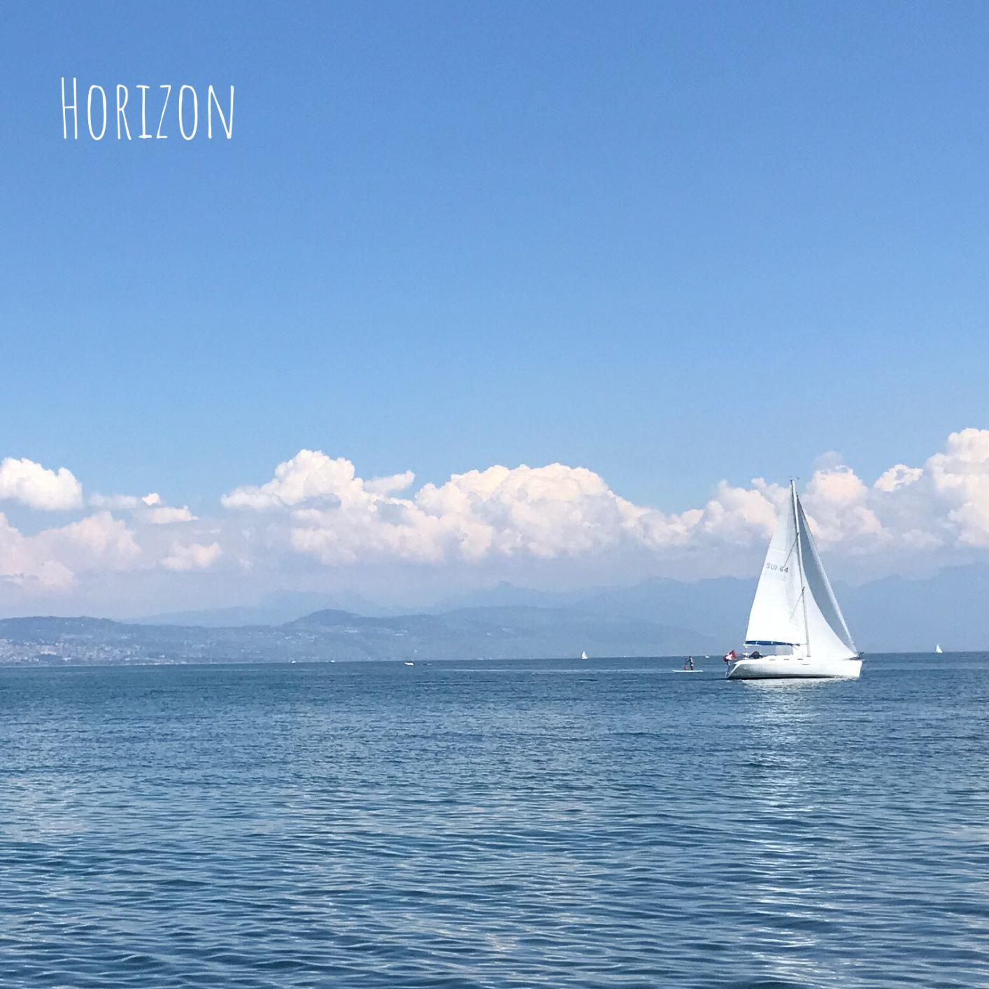 A sailing boat with wind in the sails moving forward
